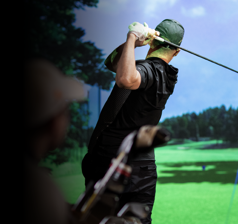 Professional Indoor Golfer Playing Trackman Simulator